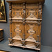 Antique cabinet with carved figures