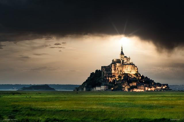 Light over storm sky at Le Mont-Saint Michel, Normandy, France