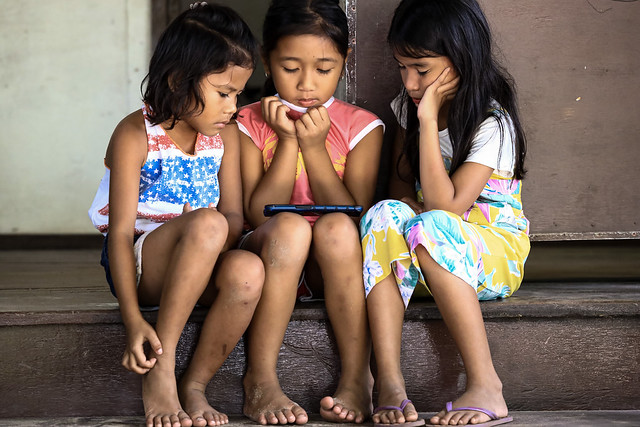 Girls watching a show on the phone in Sabang Philippines