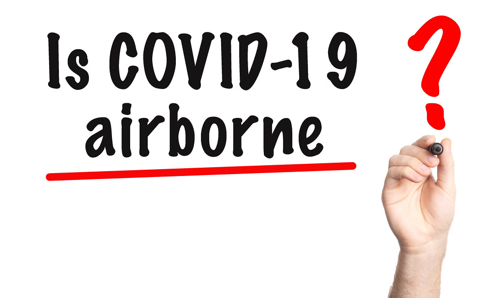 Is COVID-19 Airborne text with marker. Hand writting question Is COVID-19 Airborne on a whiteboard
