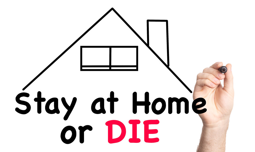 Stay at Home or Die text with marker, concept background