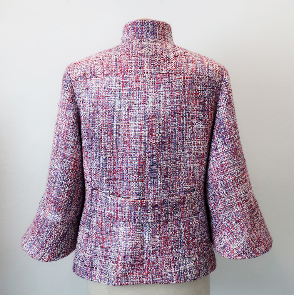 Pink jacket on from back view