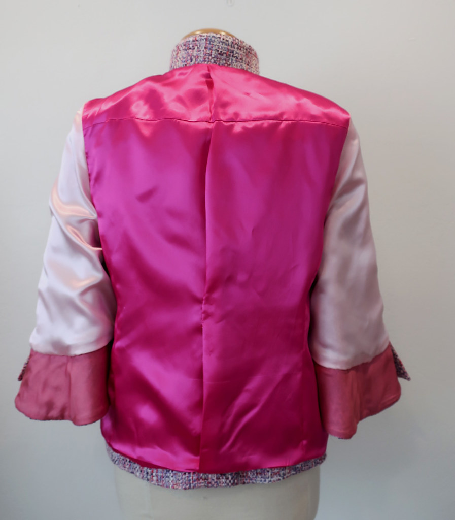 Pink jacket inside out back view on form