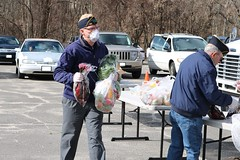 Rep. Ackert volunteered to help distribute Foodshare deliveries in Coventry.