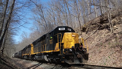 A SB Kanawha River Railroad train with two SD40s climbs a grade through a rock cut before entering a tunnel behind me.