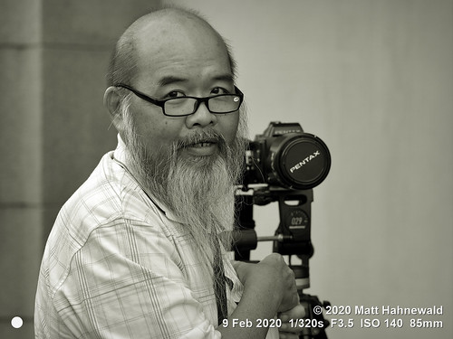 matthahnewaldphotography facingtheworld qualityphoto character head face eyes eyeglasses expression lookingatcamera chinese beard bald equipment dslrcamera lens pose right hand consensual conceptual diversity humanity living amateur professional hobby travel technology experience local photographer georgetown penang malaysia asia malaysianchinese person one male elderly man photography nikond610 nikkorafs85mmf18g 85mm street portrait closeup outdoor monochrome bandicoot posingcamera smiling pentax tripod mono greyscale clarity photoscape seveneighthsview