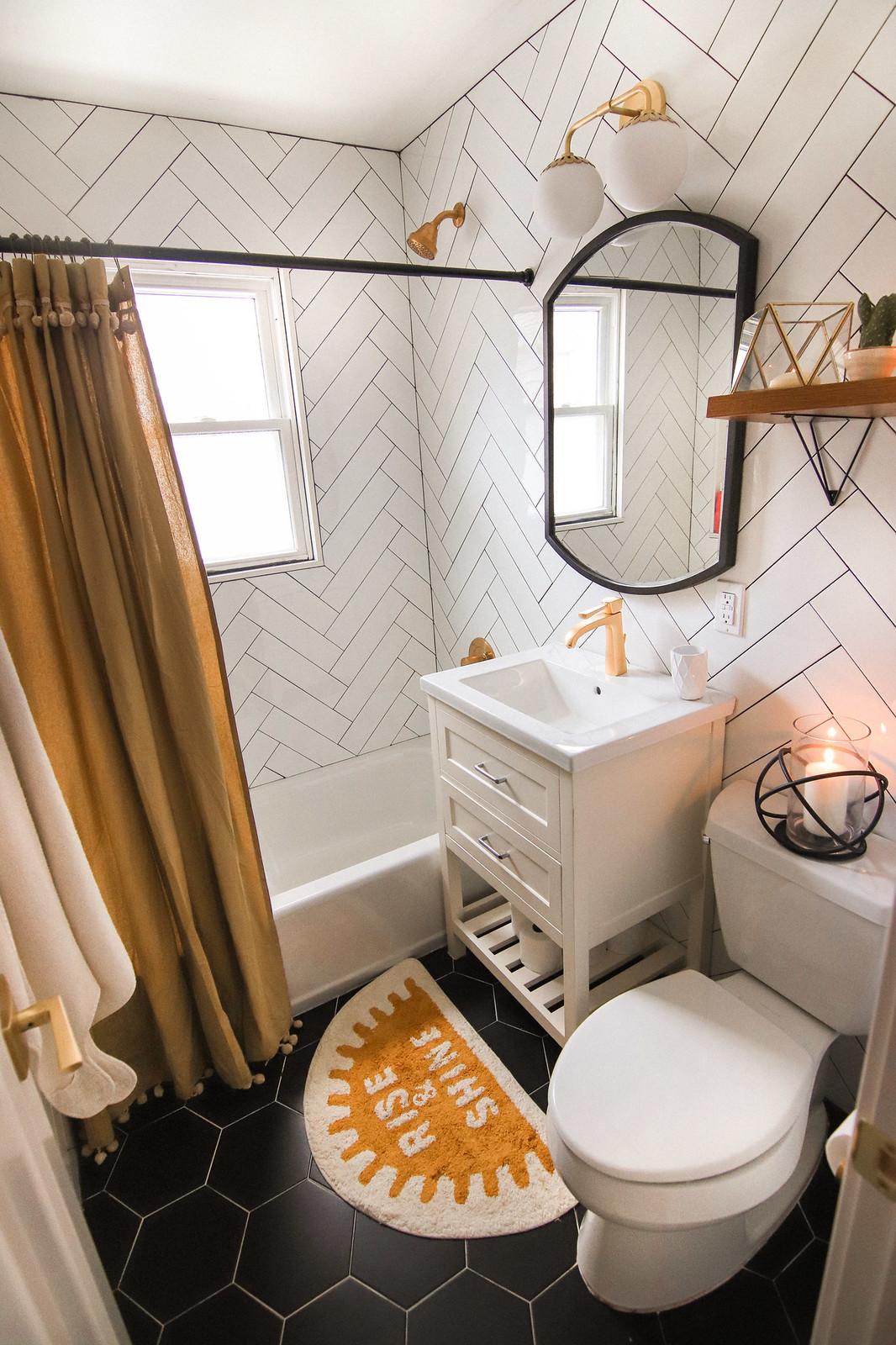 White Subway Tile Black Grout | Mustard Yellow Bathroom Accents | Large Black Hexagon Floor Tile