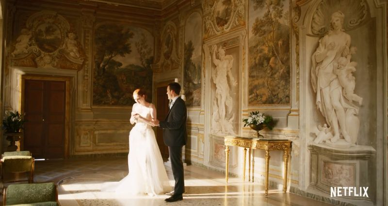 Bride and groom in a ornate room
