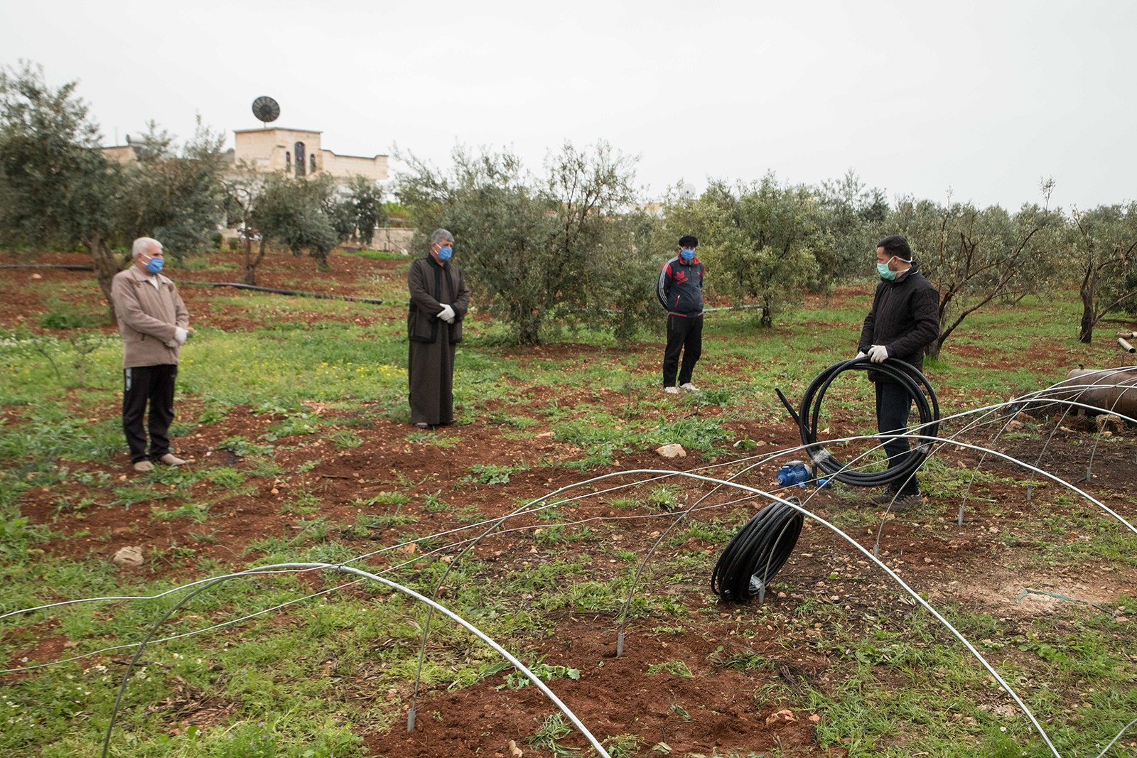 Syrian farmers install low tunnels and create nurseries while utilizing COVID-19 protection measures in the Syrian Arab Republic