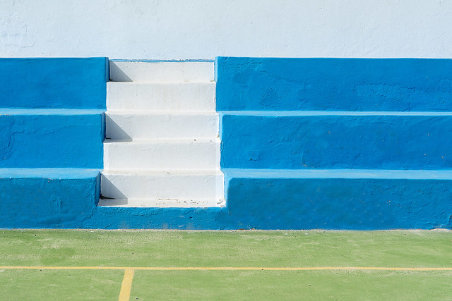 White stairs and blue tribune