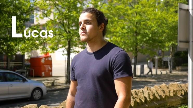 Student Lucas walking across campus