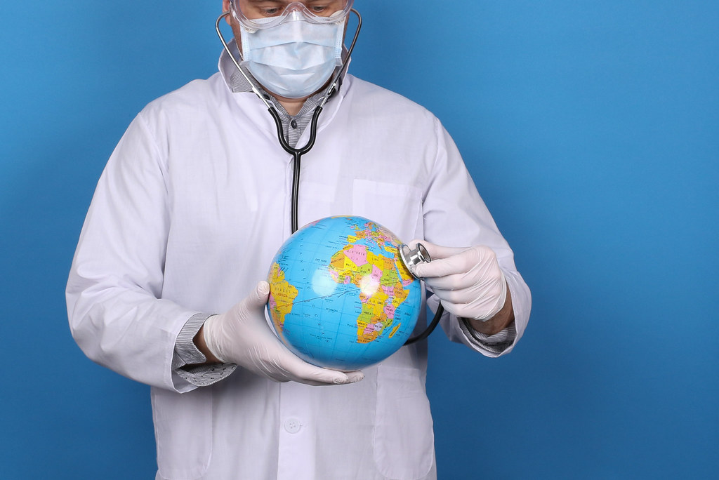 Doctor with stethoscope and globe in his hand