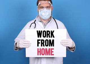 Work From Home. Doctor holding message sign for COVID-19 Pandemic at blue background | by focusonmore.com