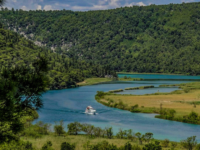 A majestic river cruise along the river of Krka National Park in Croatia.