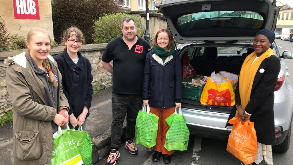Students with bags of food responding to the call for donations to Bath Foodbank