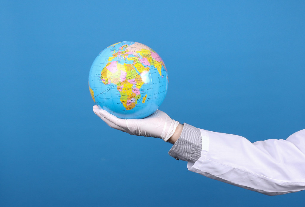 Globe in hands, coronavirus pandemic in world. Concept of global quarantine during the COVID-19