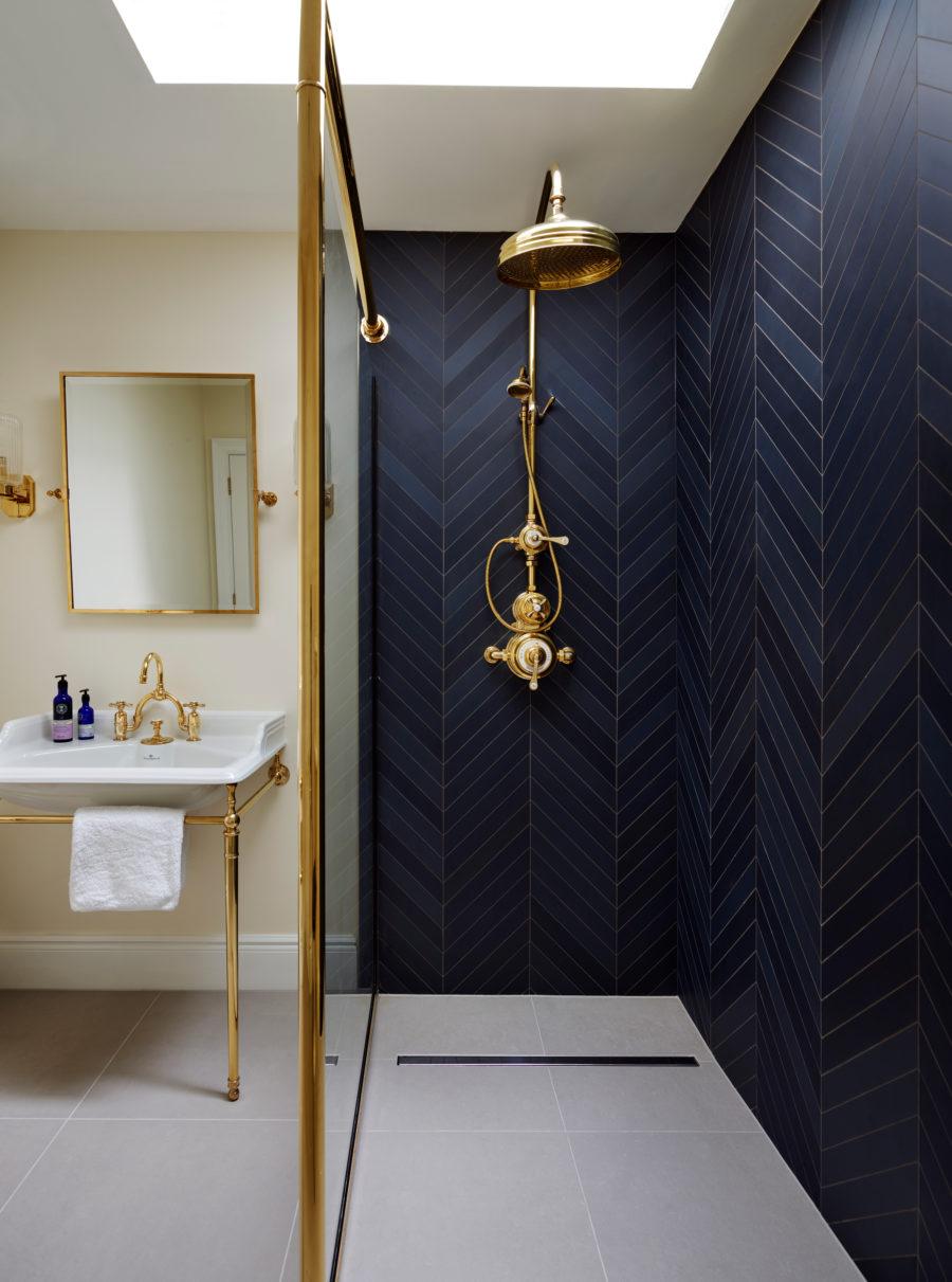 Blue and Gold Bathroom Inspiration | Navy Blue Chevron Subway Tile Shower