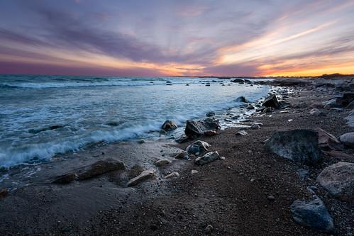 ocean beach waves rocks sand sky sunset
