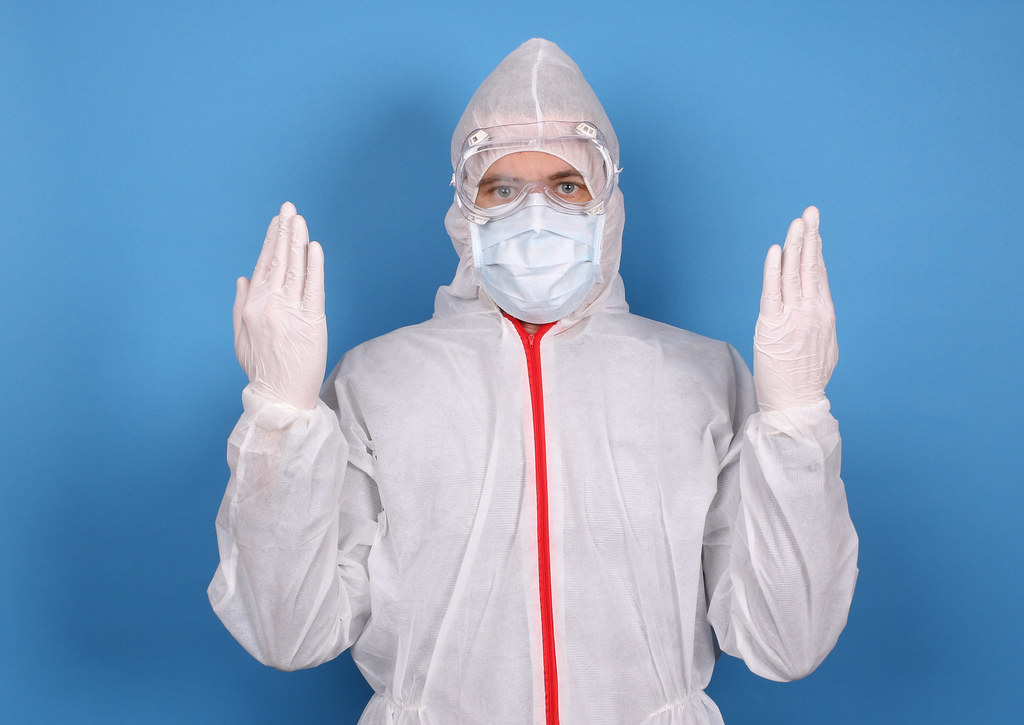 Safety virus infection concept. Man in protective suit