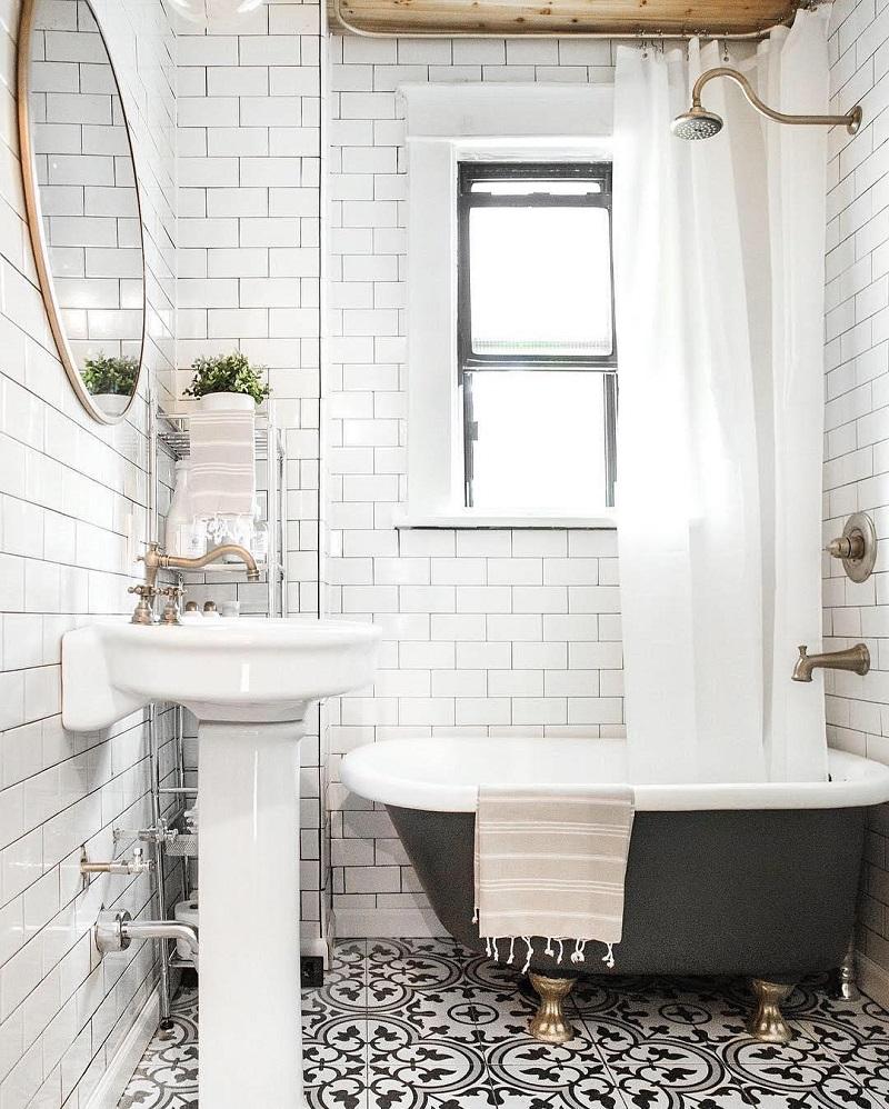 White Subway Tile Black Grout Bathroom | Black White Tile Floor | White Pedestal Sink | Tiny Bathroom Inspiration