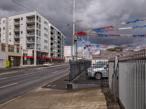 melbourne victoria australia footscray storm outdoors outdoor urban urbanlandscape pc3011 auspctaggedpc3011 footscraypc3011 buntings flags fence caryard carshopping dealer cardealer newtopographics australiannewtopographics clouds stormclouds diagonals line lines apartments flats hopkinsstreet cloudporn drama cloudy footscary red whitw white blue redwhiteandblue