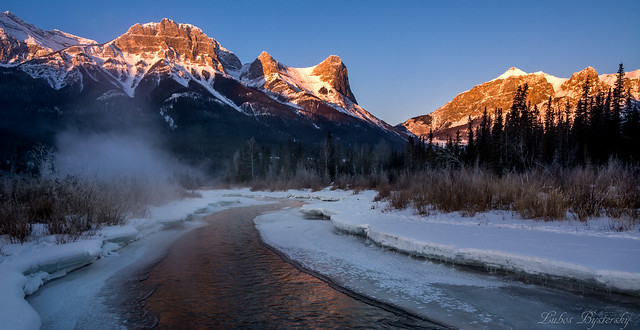 First sun rays in Canadian Rockies