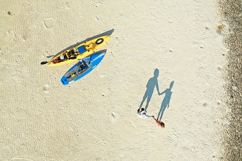 family love togetherness shadowsonthesand shadows sandbar sand sanddunes holdinghands holdinghandsonthebeach drone droneflyingflorida droneview viewfromabove aerialview aerialviewofwomaninbikini aerialviewofwomanonbeach dji mavicpro2