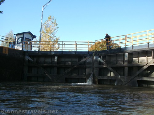 The lock operator at Lock 32 crossing the tops of the gates before opening them, Erie Canal, Pittsford, New York