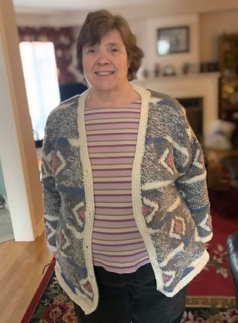 Nancy had a knee replacement in January...This is what she she knit herself while recovering! The photo shows before she sewed on the buttons.