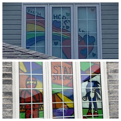 Two windows my daughter and grandsons painted!