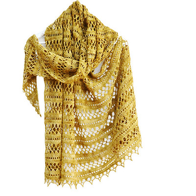 Here is one for our crocheters! Are you ready for something that looks like summer crocheted in this case with Malabrigo Sock in 803 Ochre! Pattern is Suncatcher by Elena Fedotova.