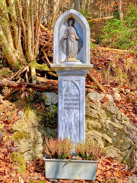 Maria sculpture beside a hiking path near Kiefersfelden in Bavaria, Germany