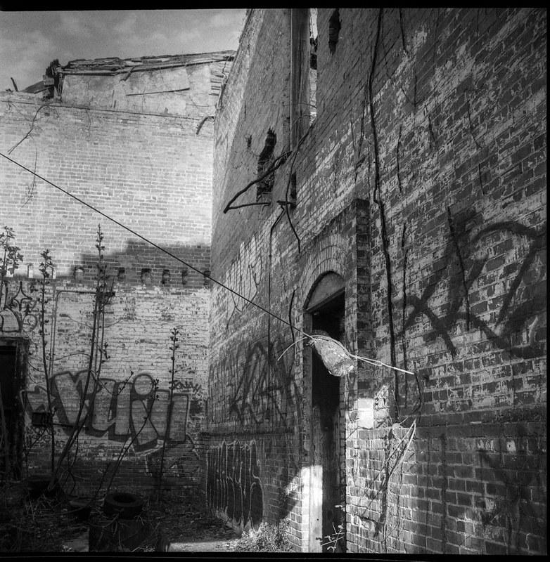 urban decay, interior, abandoned brick mill, River District, Asheville, NC, Ricoh Dia M, Bergger Pancro 400, HC-110 developer, 4.7.20.jpg