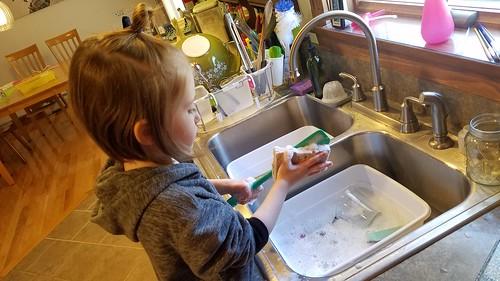 scrubbing dishes