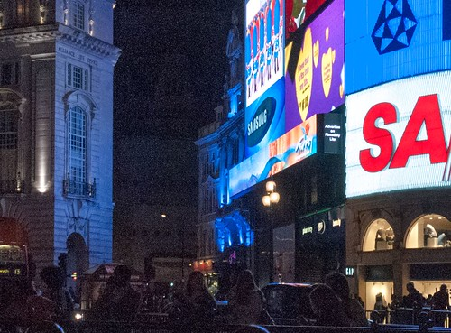 Screenshot of a noisy close up of Piccadilly Circus