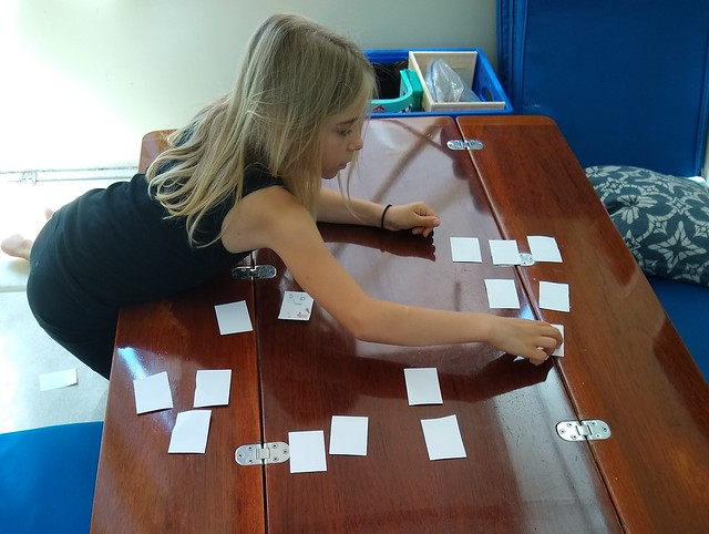 Use spelling flashcards as a memory game.