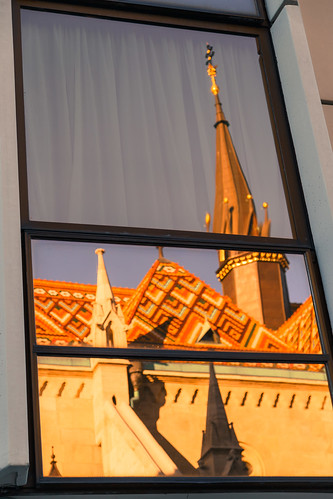 people building window architecture spire city wood art noperson indoor travel steeple photo tower outdoors mirror front housing one roof view matthias church matthiaschurch budapest hungary evening light sunset fishermansbastion