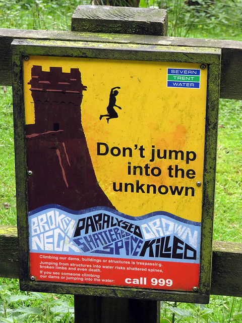 A warning about not jumping into the Ladybower Reservoir Dam in the Peaks District of England