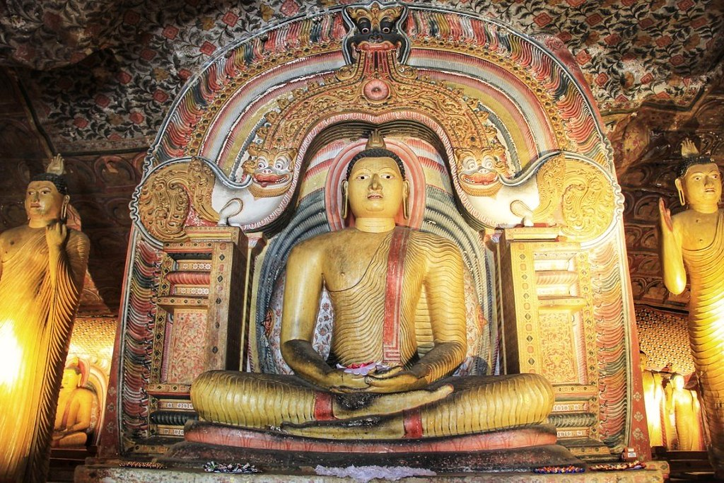 Sitting Buddha and ceiling frescoes, Dambulla Cave Temple, Sri Lanka
