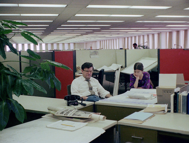New and improved scan of my Dad and sister in his office on the 58th floor of the World Trade Center's north tower. On Good Friday, The Port Authority had a