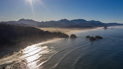oregon oregoncoast sunrise earlymorning aerial droneaerial westcoast coastline ocean ecolastatepark crescentbeach chapmanpoint cannonbeach haystackrock