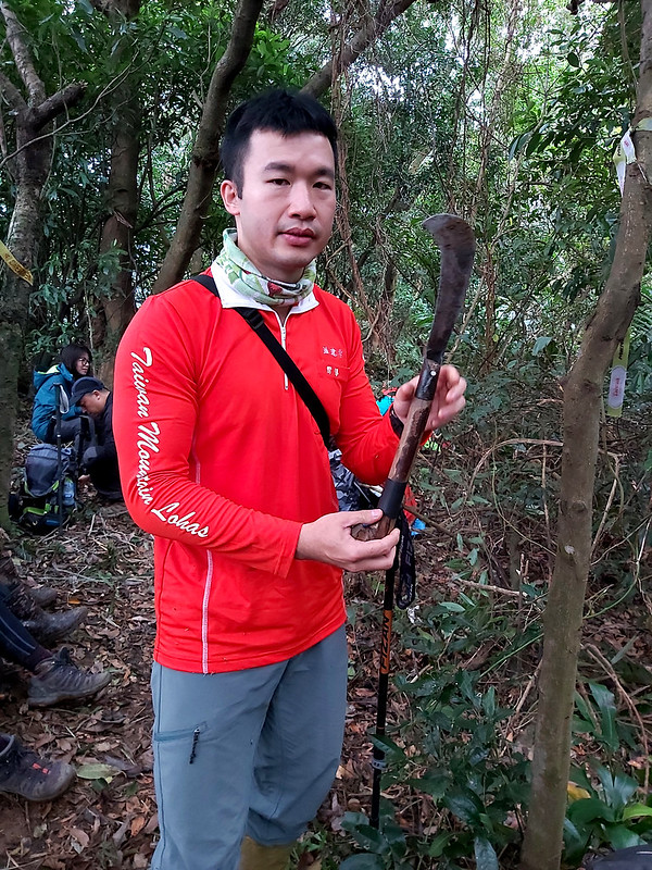A hiking guide demonstrated how to use a machete safely.