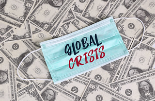 Green medical face masks with money and Global Crisis text. US Dollars and a face mask. | by focusonmore.com