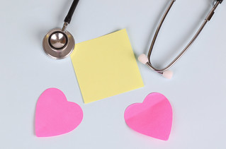Red heart with stethoscope and yellow sticky note | by focusonmore.com