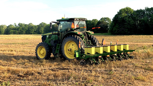 Tractor planting a field.
