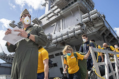 USS Theodore Roosevelt (CVN 71) depart the aircraft carrier to move to off-ship berthing. (U.S. Navy/MC1 Chris Liaghat)