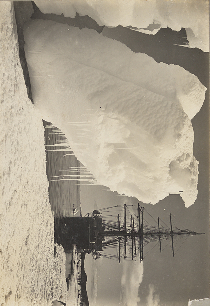 The Terra Nova off Cape Evans with capsizing Berg. January 1911, [attrib.] Herbert Ponting