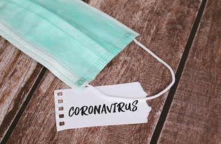 Medical protective face masks with Coronavirus text on a note | by focusonmore.com