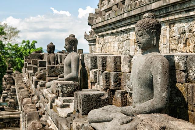Buddhas statues at the Borobudur temple on the island of Java - Indonesia