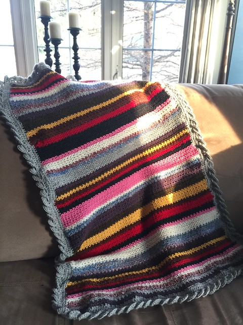 Karen made up her own pattern using the a linen stitch and a wave border for this crocheted blanket. Yarn used is Cascade 220.
